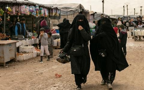 Women shop in the marketplace at Al-Hol camp, home to families of Islamic State fighters, in Hasakeh province - Credit: Maya Alleruzzo/AP