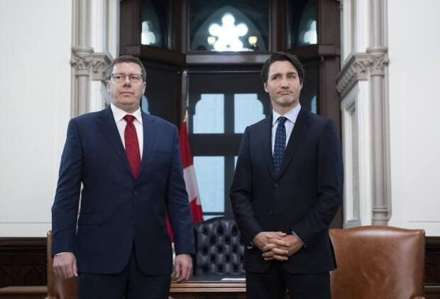 There have been some tensions lately between Premier Scott Moe and Prime Minister Justin Trudeau but they were talking Wednesday. Moe requested pandemic support from Ottawa on a few fronts. (Justin Tang/The Canadian Press - image credit)