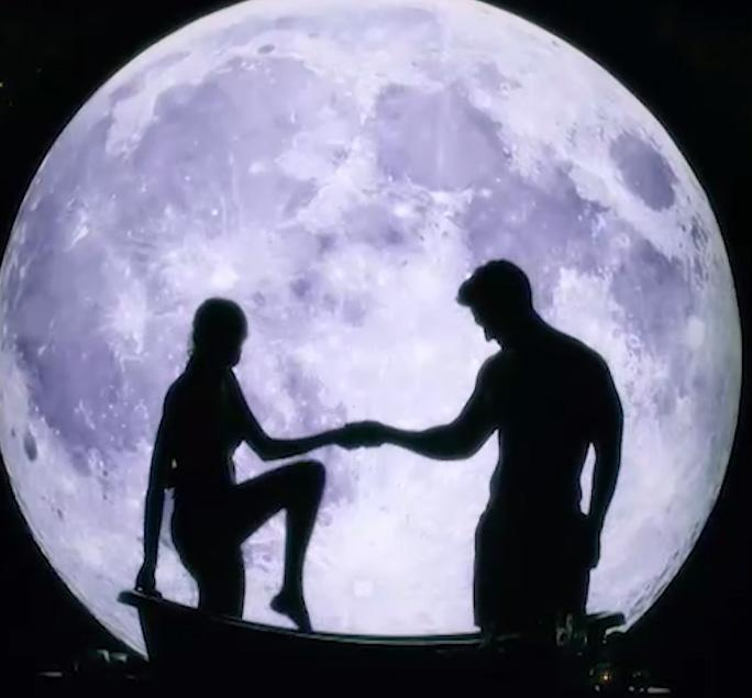 A photo from The Bachelor Australia 2019 showing a silhouette of Matt Agnew and a bachelorette getting into a bath set against a backdrop of the moon.