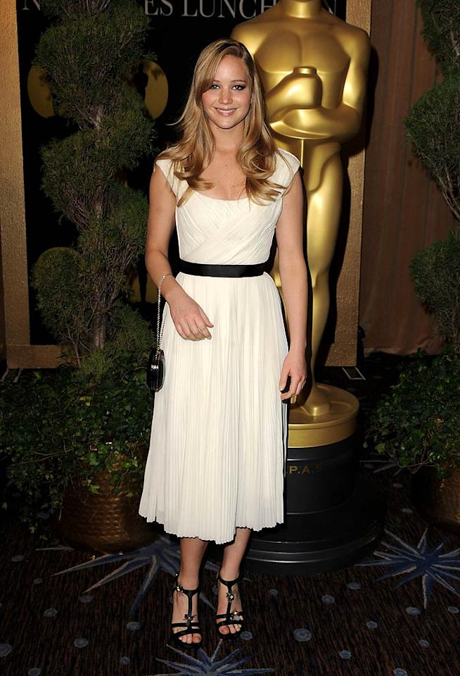 """Hollywood newcomer Jennifer Lawrence also dressed to impress at the annual Oscars luncheon. The """"Winter's Bone"""" beauty looked like a pro as she made her way down the arrivals line in a belted Chloe frock and dragonfly-adorned Roger Vivier sandals. Steve Granitz/<a href=""""http://www.wireimage.com"""" target=""""new"""">WireImage.com</a> - February 7, 2011"""