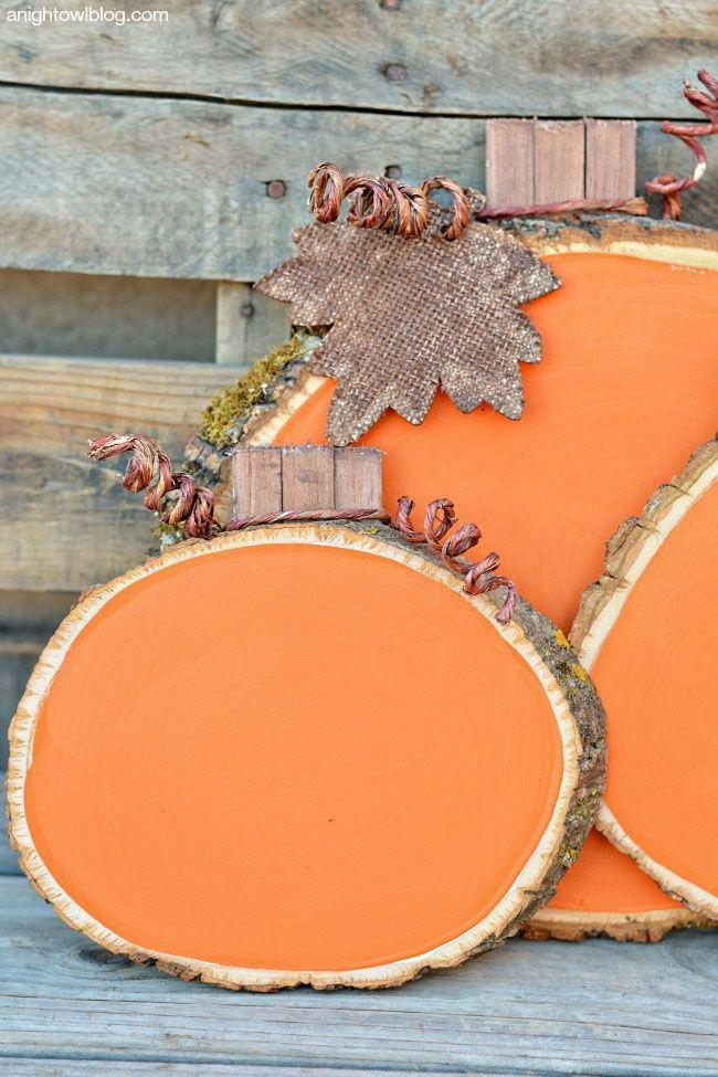 """<p>Arrange a rustic centerpiece with tree trunk-inspired wooden plaques that can be painted orange for a fun look. <br></p><p><em><a href=""""http://anightowlblog.com/2014/09/painted-wood-slice-pumpkins.html"""" rel=""""nofollow noopener"""" target=""""_blank"""" data-ylk=""""slk:Get the tutorial at A Night Owl »"""" class=""""link rapid-noclick-resp"""">Get the tutorial at A Night Owl »</a></em></p>"""