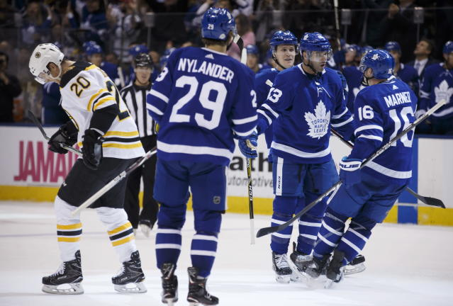 Toronto Maple Leafs center Nazem Kadri (43) celebrates his goal with Mitchell Marner (16) as Boston Bruins centre Riley Nash (20) skates off during the second period of an NHL hockey game Saturday, Feb. 24, 2018, in Toronto. (Cole Burston/The Canadian Press via AP)