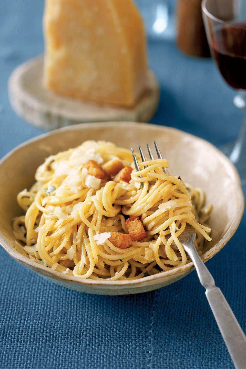 "Quick and easy pasta begins with basic ingredients, such as mushrooms, onions, and red peppers. An egg yolk is tossed with the ingredients and heated through before serving to glaze the pasta in rich, creamy flavor. Finish with a sprinkle of a fragrant, nutty cheese. <a href=""https://www.countryliving.com/food-drinks/recipes/a791/easy-pantry-pasta/"" rel=""nofollow noopener"" target=""_blank"" data-ylk=""slk:Get the recipe"" class=""link rapid-noclick-resp""><strong>Get the recipe</strong></a><strong>.</strong>"