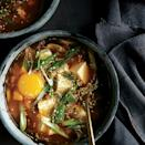 """Not only is a ton of chopped kimchi utilized here, but the kimchi liquid also forms the base for this quick weeknight dinner. <a href=""""https://www.epicurious.com/recipes/food/views/spicy-kimchi-tofu-stew-51223900?mbid=synd_yahoo_rss"""" rel=""""nofollow noopener"""" target=""""_blank"""" data-ylk=""""slk:See recipe."""" class=""""link rapid-noclick-resp"""">See recipe.</a>"""