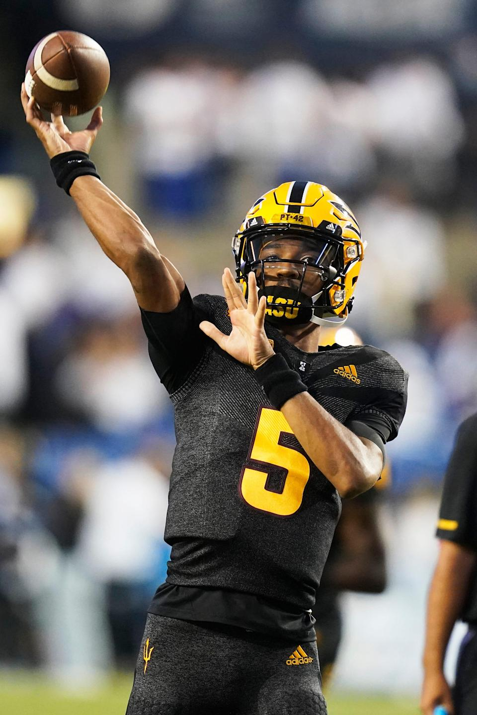 Arizona State quarterback Jayden Daniels warms up for the team's NCAA college football game against BYU on Saturday, Sept. 18, 2021, in Provo, Utah. (AP Photo/Rick Bowmer)