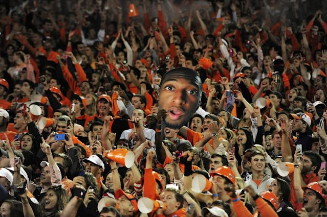 Clemson fans hold a photo of Clemson quarterback Tajh Boyd during the first half of an NCAA college football game against the Florida State, Saturday, Oct. 19, 2013, in Clemson, S.C. (AP Photo/Richard Shiro)
