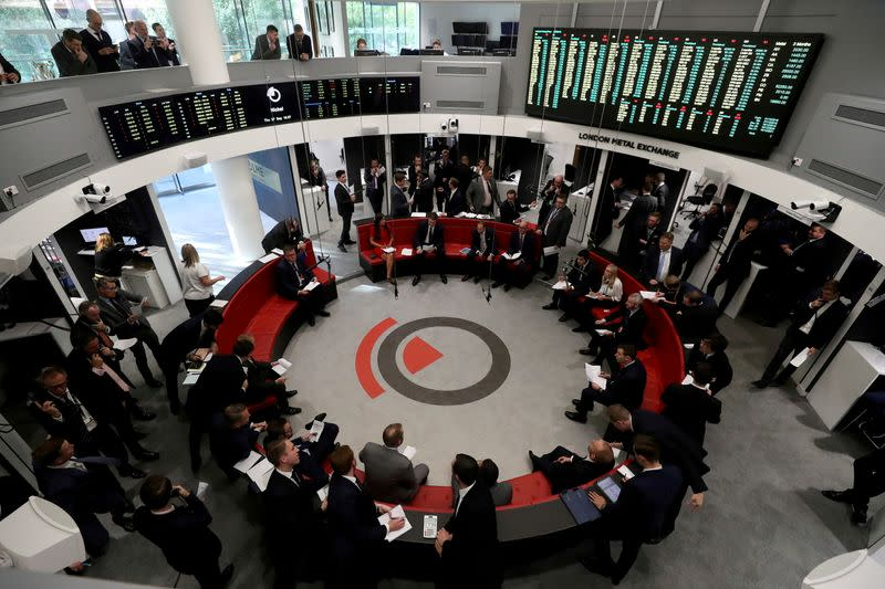 FILE PHOTO: Traders work on the floor of the London Metal Exchange