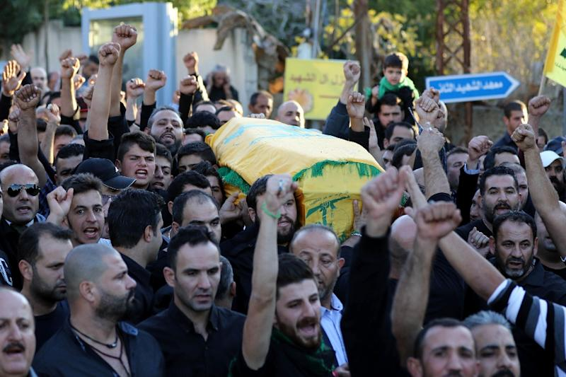 Mourners chant slogans as they carry the body of Adel Termos, killed in a twin bombing attack, during his funeral in the village of Tallussa in the Nabatiyeh governorate on November 13, 2015 (AFP Photo/Mahmoud Zayyat)