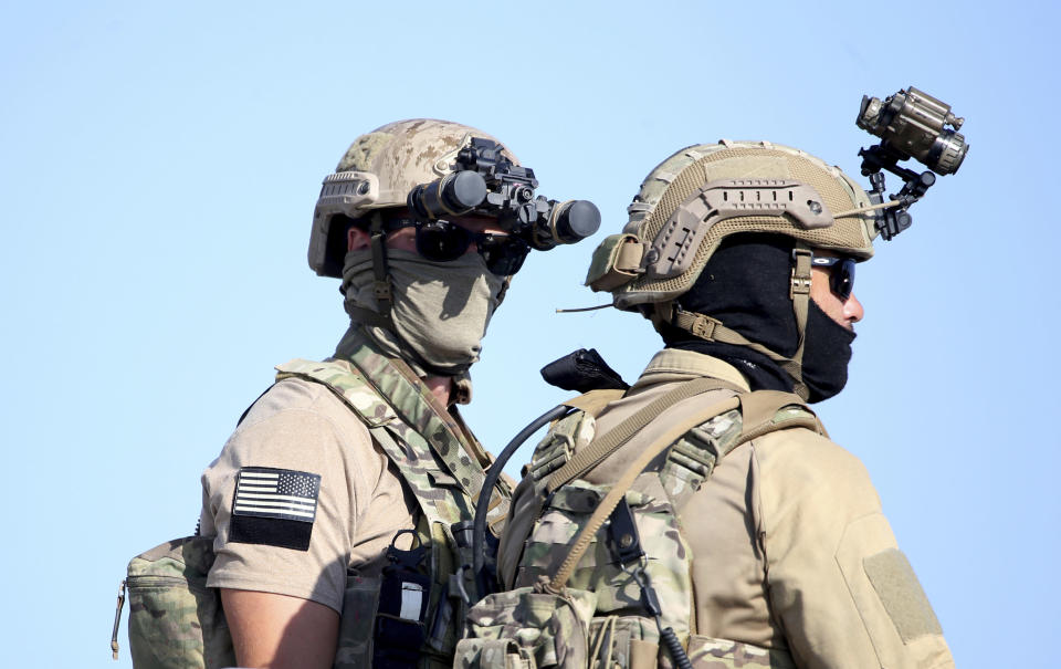 A U.S. Navy SEAL special forces operator, left, stands with a colleague during a joint U.S.-Cyprus military drill at Limassol port on Friday, Sept. 10, 2021. Cyprus' Defense Minister Charalambos Petrides said the U.S. and Cyprus are on the same strategic path to ensure security and stability in a turbulent region and that continued close cooperation between the special forces of both countries aim to counter threats from potential terrorist acts. (AP Photo/Philippos Christou)