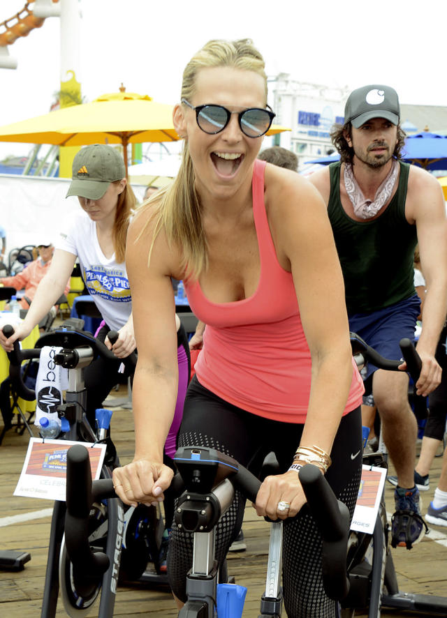 <p>Burn, baby, burn! The models was one of the hundreds of people in L.A. who took part in a five-hour ride on the Santa Monica Pier to raise more than $1 million to send less fortunate children to summer camp. (Photo: Michael Bezjian/WireImage) </p>