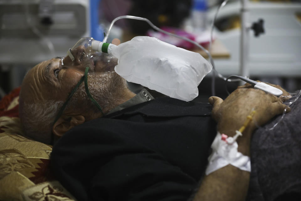 A corona patient receives oxygen in a hospital in Idlib, Syria, Saturday, Nov. 14, 2020. At one of two coronavirus hospitals in Syria's rebel-held Idlib province, overwhelmed medical staff tend to patients drifting in and out of consciousness. As confirmed case numbers rise to as many as 500 a day, so does the demand for beds in the intensive care ward (AP Photo/Ghaith Alsayed)