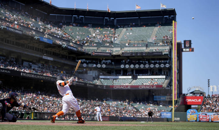 San Francisco Giants' Brandon Crawford, second from left, hits a solo home run against the Washington Nationals during the sixth inning of a baseball game Saturday, July 10, 2021, in San Francisco. (AP Photo/Tony Avelar)