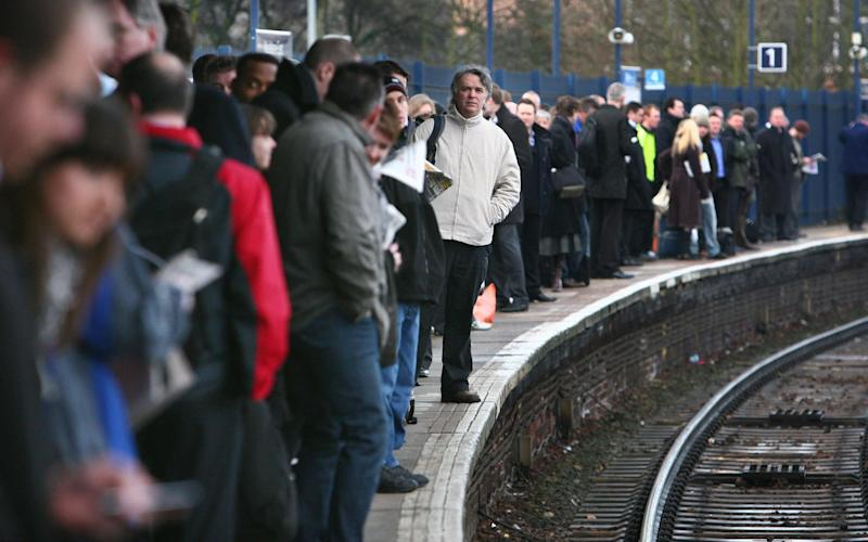First class carriages on busy trains should removed to ease overcrowding, the Department for Transport - PA