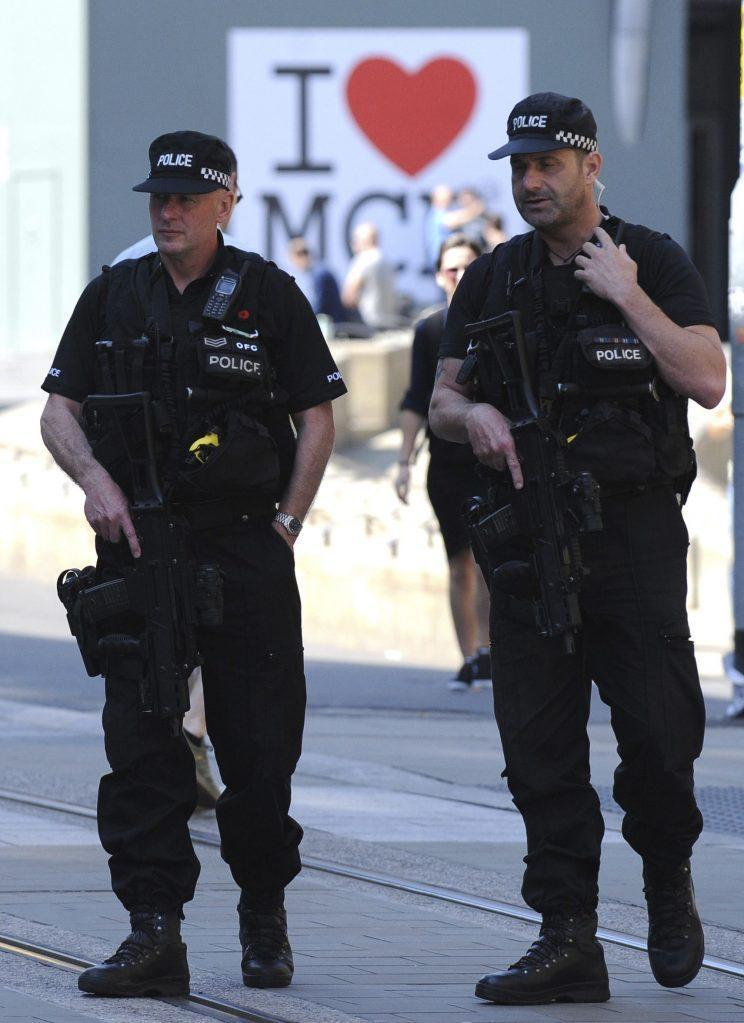 Armed police in Manchester following the attack (Rex)