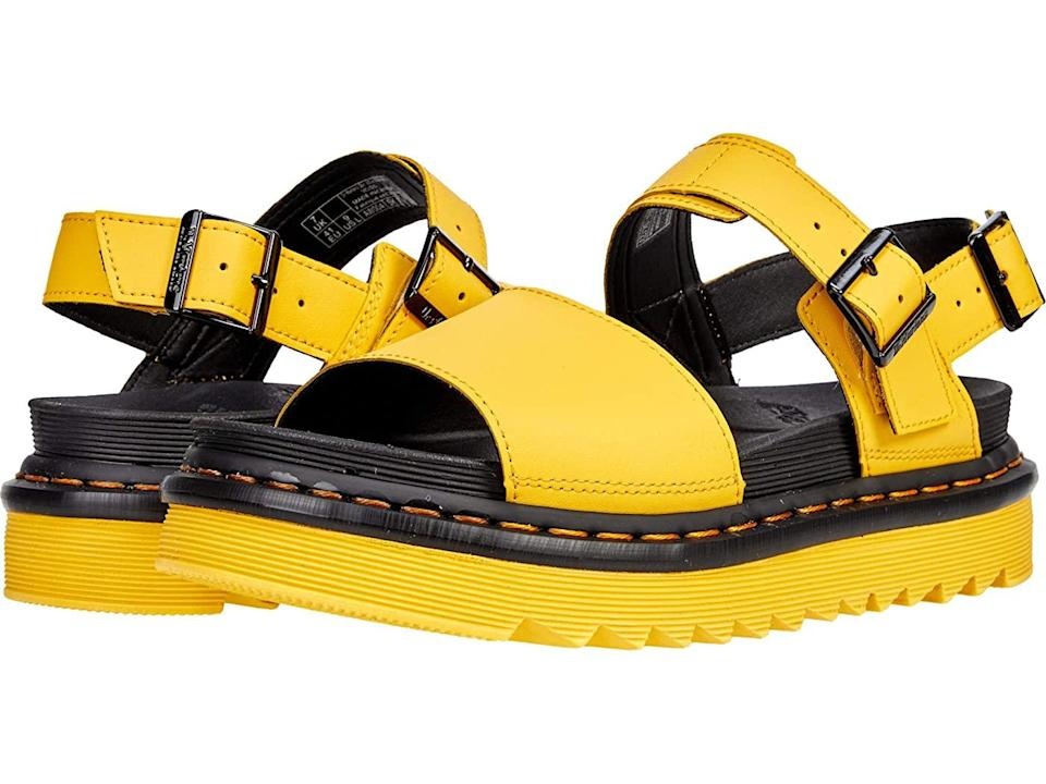 "<h2>Dr. Martens Voss Sandals</h2><br><em>Shop sandals at <strong><a href=""https://www.zappos.com/sandals"" rel=""nofollow noopener"" target=""_blank"" data-ylk=""slk:Zappos"" class=""link rapid-noclick-resp"">Zappos</a></strong></em><br><br><strong>Dr. Martens</strong> Dr. Martens Voss, $, available at <a href=""https://go.skimresources.com/?id=30283X879131&url=https%3A%2F%2Fwww.zappos.com%2Fp%2Fdr-martens-voss-yellow%2Fproduct%2F8983135%2Fcolor%2F764"" rel=""nofollow noopener"" target=""_blank"" data-ylk=""slk:Zappos"" class=""link rapid-noclick-resp"">Zappos</a>"