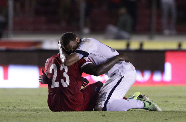 Terrence Boyd of the U.S., right, embraces Panama's Felipe Baloy after the U.S. defeated Panama in a 2014 World Cup qualifying soccer match in Panama City, Tuesday, Oct. 15, 2013. The United States rallied for a 3-2 win at Panama on Tuesday night that left Mexico's World Cup hopes alive and knocked out the Panamanians. (AP Photo/Arnulfo Franco)