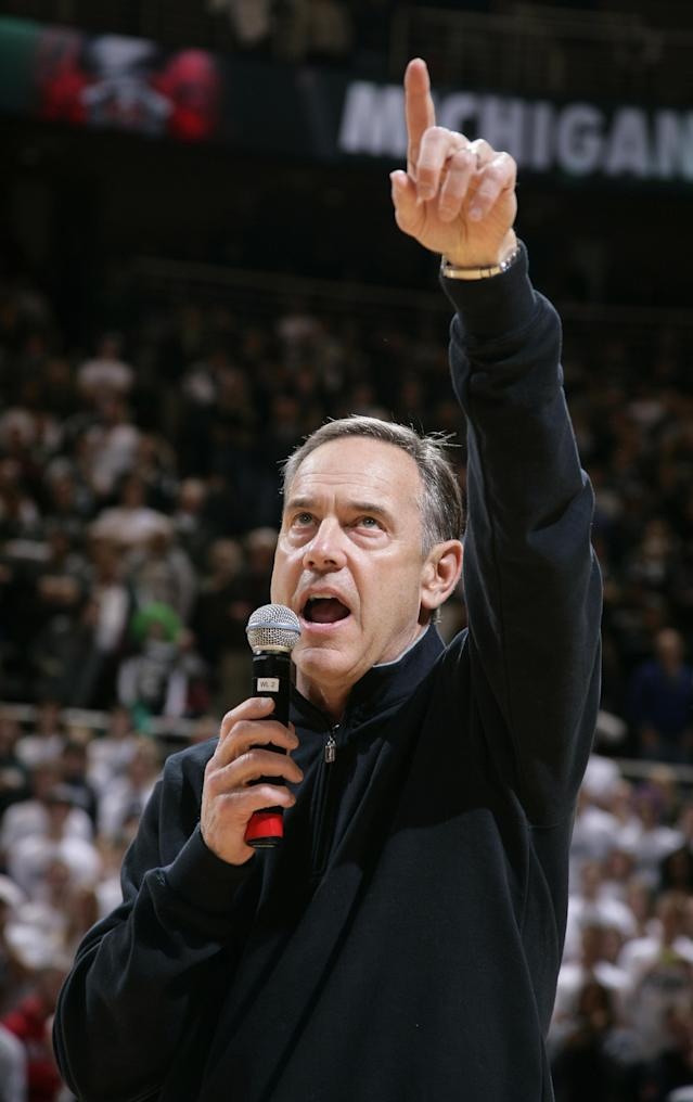 Michigan State football coach Mark Dantonio addresses the crowd at an NCAA college basketball game between Michigan State and Ohio State, Tuesday, Jan. 7, 2014, in East Lansing, Mich. (AP Photo/Al Goldis)
