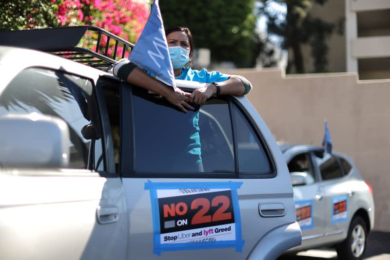 FILE PHOTO: Leandra Montiel, 34, joins a protest by Uber and Lyft rideshare drivers against California Proposition 22 in Los Angeles