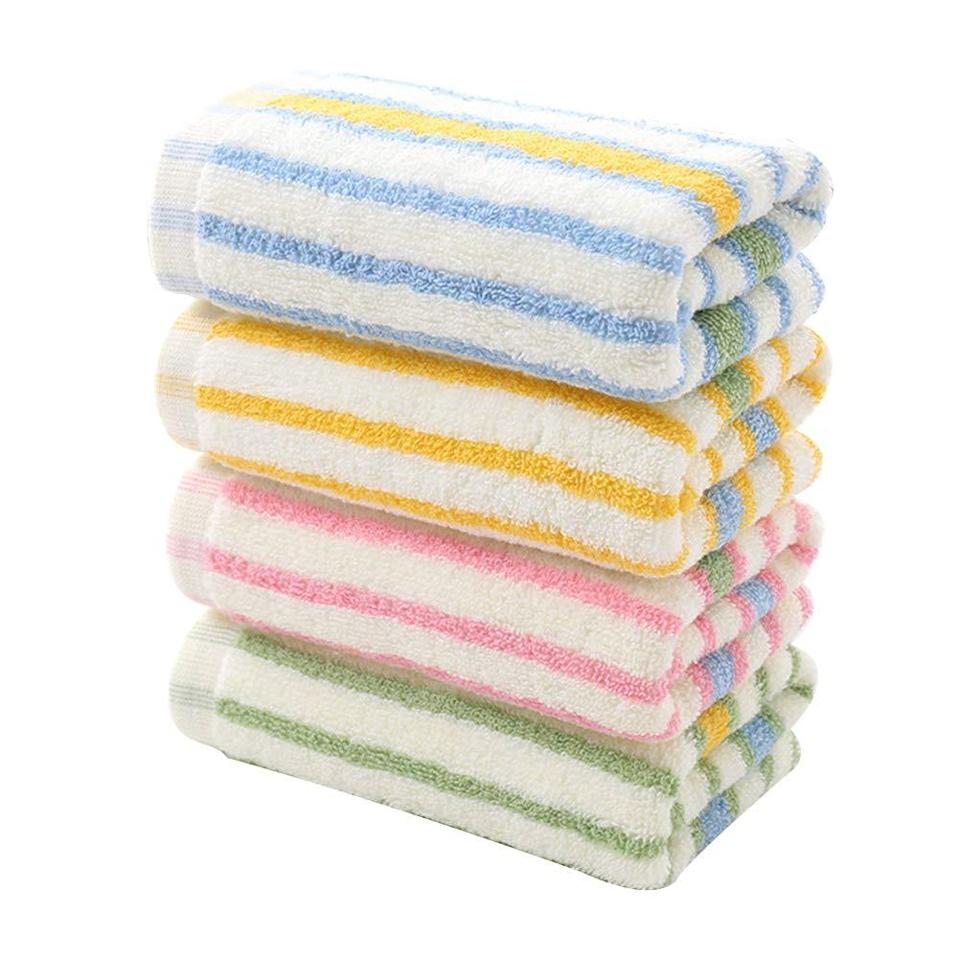 """<h3>Striped Cotton Hand Towels</h3><br>Add a pop of cheery-pastel stripes to your bathroom with this pack of 100%-cotton hand towels. <br><br><strong>TOPBATHY</strong> Colorful Striped Cotton Hand Towels (4-Pack), $, available at <a href=""""https://amzn.to/2ZXYt32"""" rel=""""nofollow noopener"""" target=""""_blank"""" data-ylk=""""slk:Amazon"""" class=""""link rapid-noclick-resp"""">Amazon</a>"""