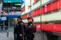 New York City police officers stand guard after a shooting incident in Times Square, New York