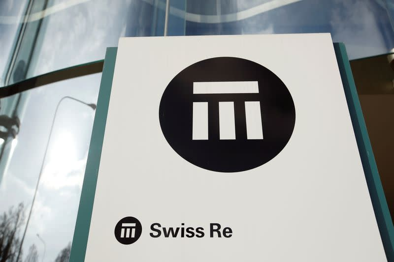 FILE PHOTO: The logo of insurance company Swiss Re is seen in front of its headquarters in Zurich