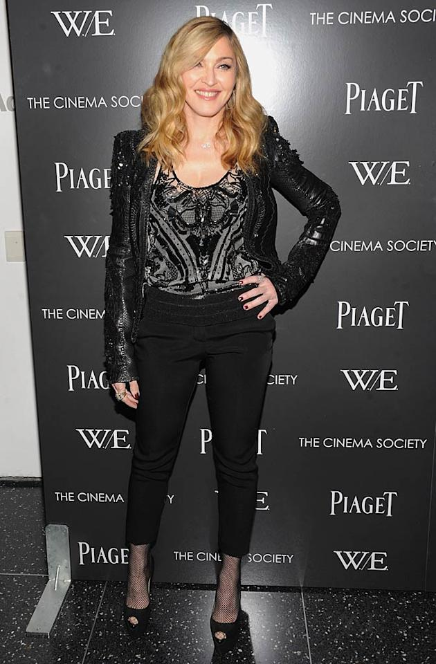 Elsewhere in Manhattan, Madonna -- who was announced this week as the performer at the Super Bowl XLVI halftime show -- strutted her stuff in a cute outfit designed by Roberto Cavalli. Say what you will about the Material Girl, but she's still got it at 53! (12/04/2011)