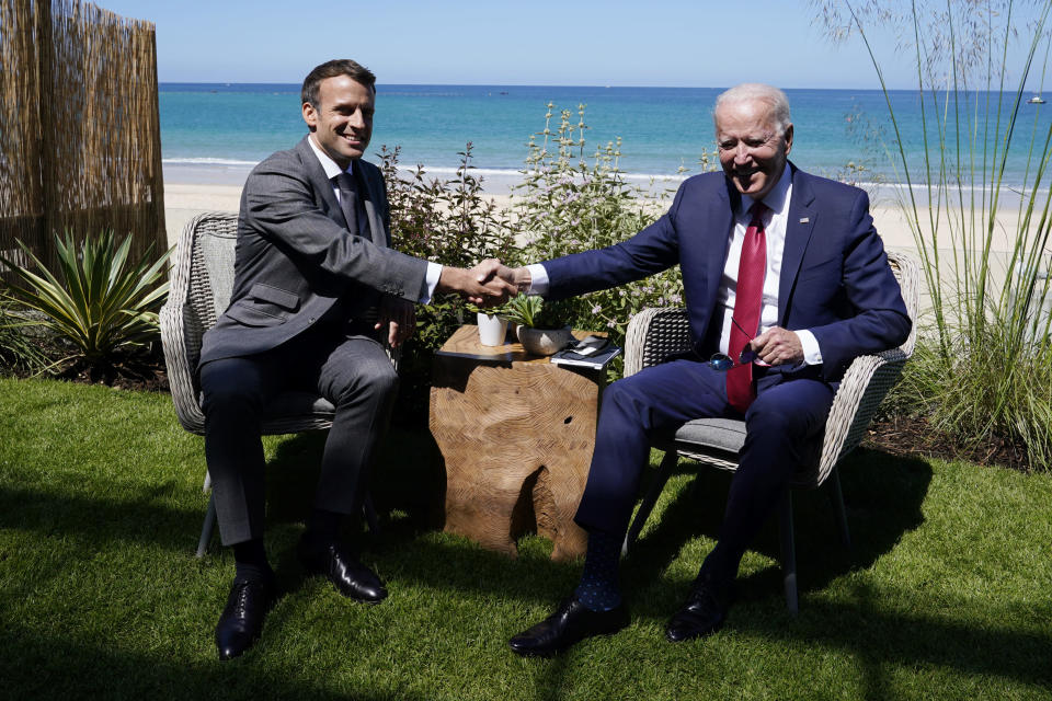 """FILE - In this June 12, 2021 file photo, President Joe Biden and French President Emmanuel Macron shake hands during a bilateral meeting at the G-7 summit, in Carbis Bay, England. French President Emmanuel Macron expects """"clarifications and clear commitments"""" from President Joe Biden in a call to be held later on Wednesday to address the submarines' dispute, Macron's office said. (AP Photo/Patrick Semansky, File)"""