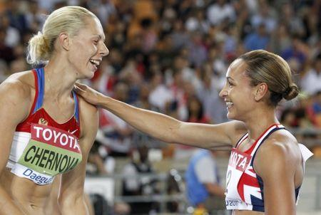FILE PHOTO - Tatyana Chernova of Russia (L) celebrates winning the women's heptathlon with Jessica Ennis of Britain after their women's 800 metres event at the IAAF World Athletics Championships in Daegu, August 30, 2011. REUTERS/Phil Noble