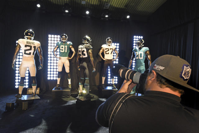 Jacksonville Jaguars new NFL football uniforms are displayed during a press conference at Everbank Field in Jacksonville, Fla., Thursday, April 19, 2018. (Bob Self/The Florida Times-Union via AP)