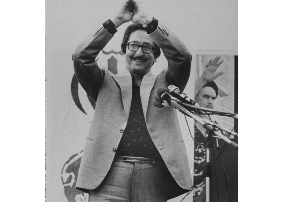 Then Iranian President Abolhassan Banisadr acknowledges cheers after speaking to thousands of Iranians in front of the U.S. Embassy in Tehran, on June 16, 1980. Banisadr, Iran's first president after the country's 1979 Islamic Revolution who fled Tehran after being impeached for challenging the growing power of clerics as the nation became a theocracy, died Saturday, Oct. 9, 2021. He was 88. (AP Photo)