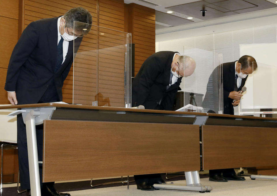 From left, Mitsui O.S.K. Lines, Ltd. Managing Executive Officer Masanori Kato, Mitsui O.S.K.Lines, Ltd. Representative Director Akihiko Ono, and Nagashiki Shipping CEO Kiyoaki Nagashiki bow during a press conference in Tokyo, Sunday, Aug. 9, 2020. The owners and operators of the grounded ship Wakashio on Sunday apologized for the accident that has led to tons of fuel leaking into Mauritius waters. (Kyodo News via AP)