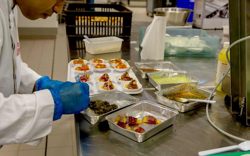 Emirates employees prepare canape selections served in first class. | Talia Avakian
