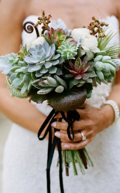 Echeveria, a green succulent from Mexico, has become ubiquitous at trendy wedding ceremonies - Credit: Weddings by Lilly