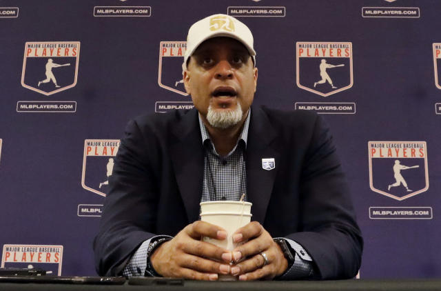 Tony Clark, executive director of the Major League Players Association, answers questions at a news conference in Phoenix. Baseball commissioner Rob Manfred is defending teams' reluctance to sign free agents last offseason and says union head Tony Clark has not responded to a pair of invitations to have a broad discussion about players' concerns and changes in the way the game is played. (AP Photo)