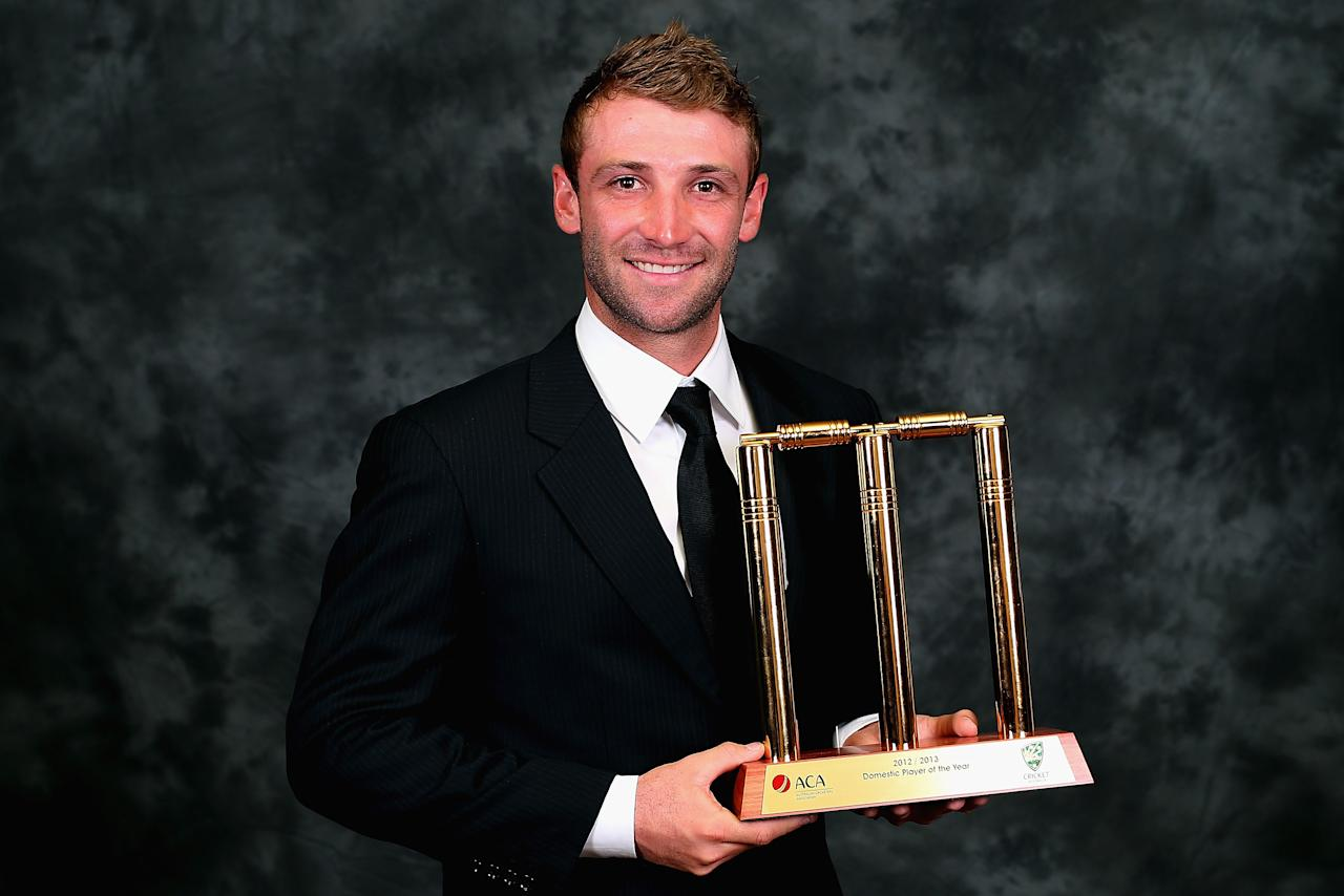 MELBOURNE, AUSTRALIA - FEBRUARY 04:  Phillip Hughes of Australia poses with his trophy after being named the Domestic Player of the Year at the 2013 Allan Border Medal awards ceremony at Crown Palladium on February 4, 2013 in Melbourne, Australia.  (Photo by Quinn Rooney/Getty Images)