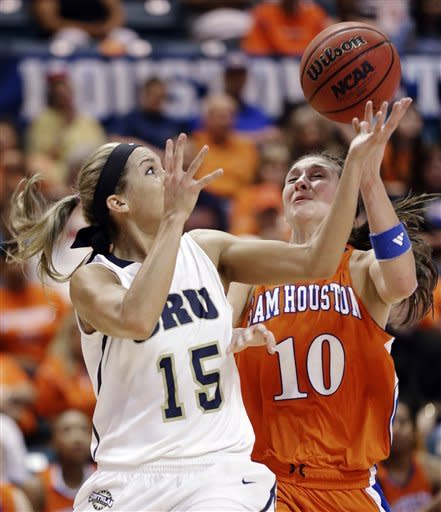 Oral Roberts' Kevi Luper (15) reaches for a loose ball with Sam Houston State's Britni Martin (10) during the first half of the Southland Conference championship NCAA college basketball game, Saturday, March 16, 2013, in Katy, Texas. (AP Photo/David J. Phillip)