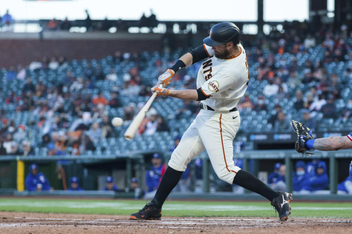 San Francisco Giants' Brandon Belt hits a solo home run against the Texas Rangers during the fourth inning of a baseball game in San Francisco, Monday, May 10, 2021. (AP Photo/John Hefti)