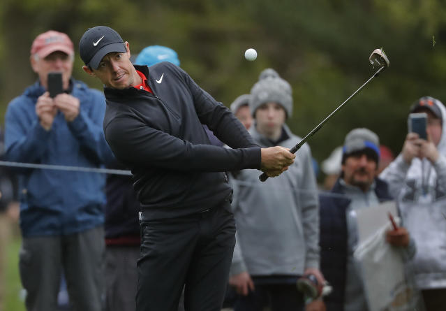 Rory McIlroy chips onto the seventh green during a practice round for the PGA Championship golf tournament, Tuesday, May 14, 2019, in Farmingdale, N.Y. (AP Photo/Julie Jacobson)