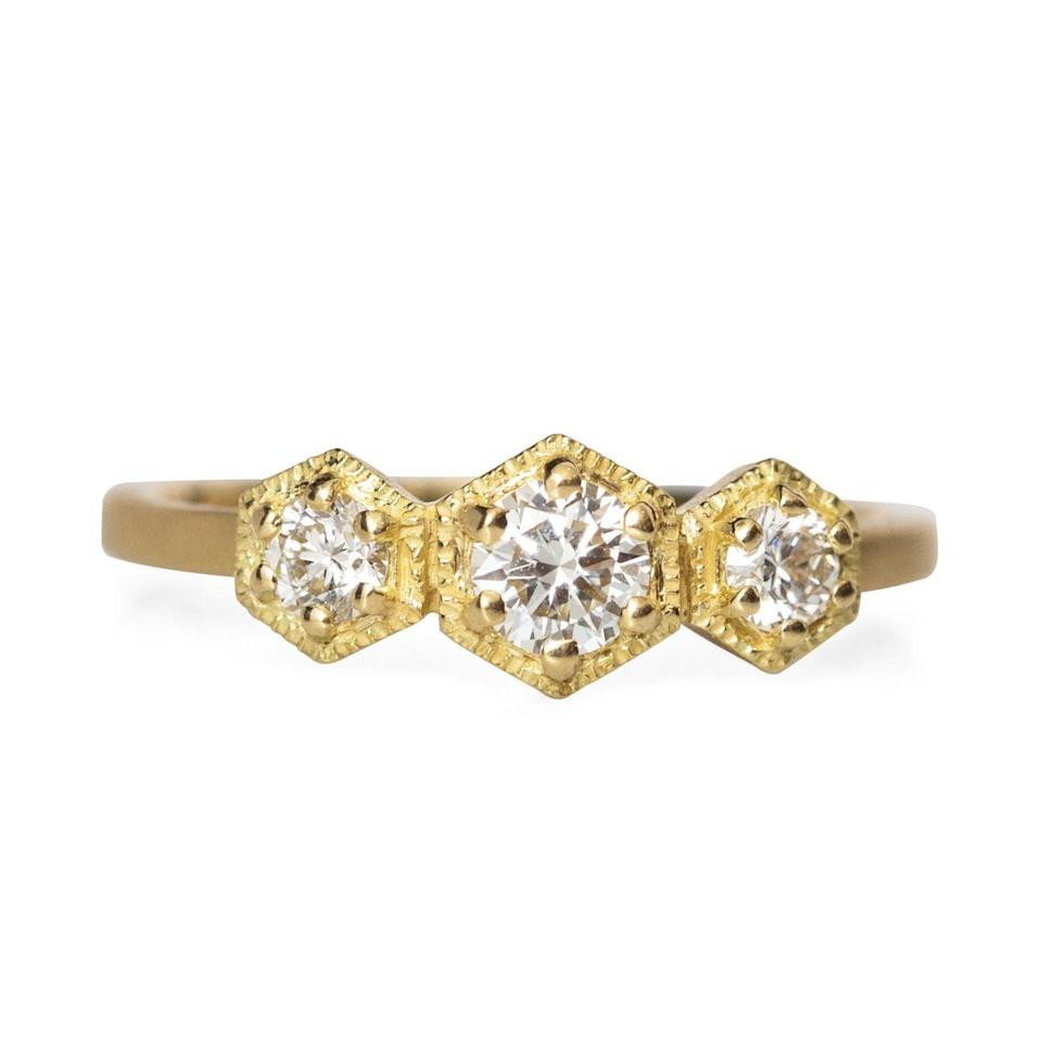 """<p>With a yellow gold band and hexagon diamonds, this <a href=""""https://www.popsugar.com/buy/White-Diamond-Triple-Hexagon-Ring-531765?p_name=White%20Diamond%20Triple%20Hexagon%20Ring&retailer=catbirdnyc.com&pid=531765&price=3%2C410&evar1=fab%3Aus&evar9=7954958&evar98=https%3A%2F%2Fwww.popsugar.com%2Fphoto-gallery%2F7954958%2Fimage%2F47032818%2FWhite-Diamond-Triple-Hexagon-Ring&list1=shopping%2Cwedding%2Cjewelry%2Crings%2Cengagement%20rings%2Cfashion%20shopping&prop13=api&pdata=1"""" rel=""""nofollow noopener"""" class=""""link rapid-noclick-resp"""" target=""""_blank"""" data-ylk=""""slk:White Diamond Triple Hexagon Ring"""">White Diamond Triple Hexagon Ring</a> ($3,410) will make you do a double take.</p>"""
