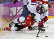 Hilary Knight of the United States (21) passes the puck against Canada during the first period of the women's gold medal ice hockey game at the 2014 Winter Olympics, Thursday, Feb. 20, 2014, in Sochi, Russia. (AP Photo/Mark Humphrey)