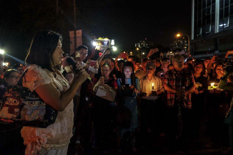 At candlelight vigil, hundreds pray for safe return of abducted pastor