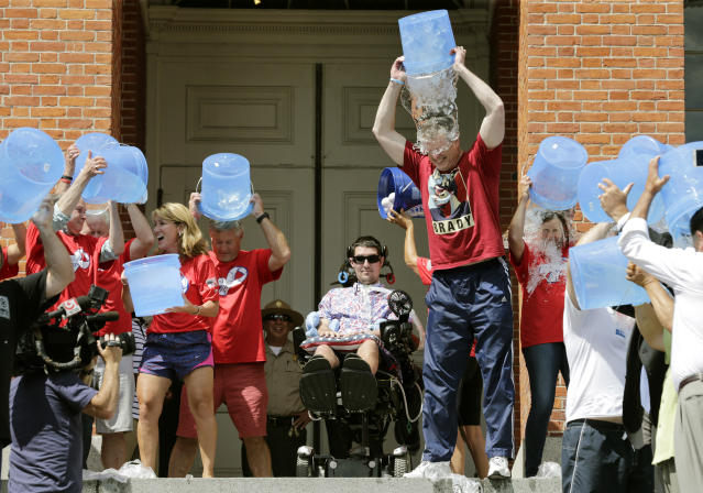 Massachusetts Gov. Charlie Baker, right center, and Lt. Gov. Karyn Polito, third from left, participate in the Ice Bucket Challenge with its inspiration Pete Frates, (center), to raise money for ALS research Monday, Aug. 10, 2015, at the Statehouse in Boston. (AP)