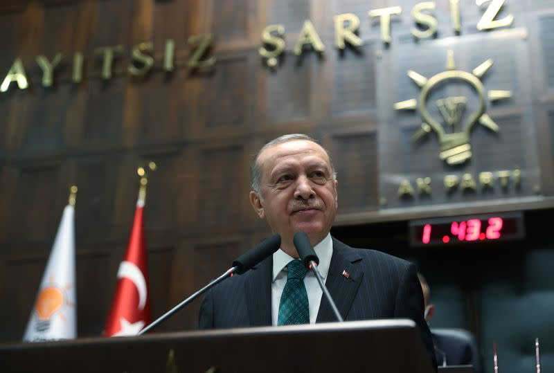 Turkish President Tayyip Erdogan addresses members of parliament from his ruling AK Party in Ankara