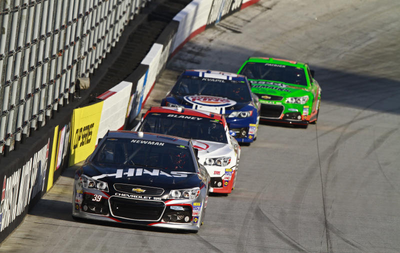 NASCAR Sprint Cup Series driver Ryan Newman (39) leads Dave Blaney, Travis Kvapil, and Danica Patrick during morning practice for the Sprint Cup Series Food City 500 auto race, Saturday, March 16, 2013, in Bristol, Tenn. The race will be run on Sunday. (AP Photo/Wade Payne)