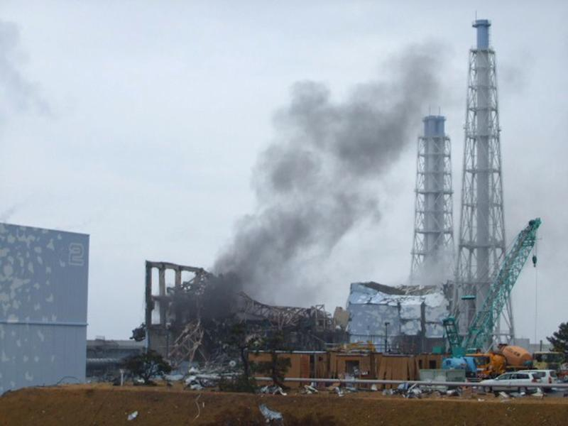 FILE - In this March 21, 2011 file photo released by Tokyo Electric Power Co. (TEPCO), smoke rises from the Unit 3 reactor of the tsunami-damaged Fukushima Dai-ichi nuclear plant in Okuma town, Fukushima prefecture, northeastern Japan. The operator of a Japanese nuclear plant that went into a tsunami-triggered meltdown knew the risks from highly radioactive water at the site but sent in crews without adequate protection or warnings, a worker said in a legal complaint filed Tuesday, Oct. 30, 2012. Asked about the allegations, a TEPCO spokesman said the plant was aware of water leaks elsewhere but couldn't anticipate the water problem in Unit 3's basement. (AP Photo/Tokyo Electric Power Co., File) EDITORIAL USE ONLY
