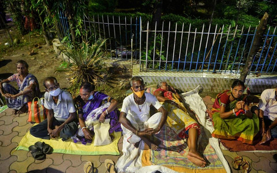 People camp overnight to get a Covid-19 vaccine at the government run district hospital in Siliguri, India on 20 September 2021 - Diptendu Dutta/AFP