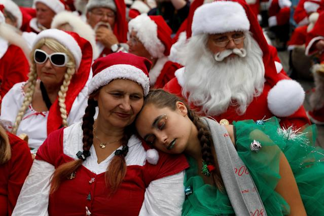 <p>A person dressed as a Christmas tree rests during a canal boat cruise during the World Santa Claus Congress, an annual event held every summer in Copenhagen, Denmark, July 23, 2018. (Photo: Andrew Kelly/Reuters) </p>
