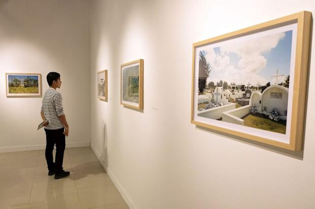 A visitor browses artwork on display at the ;Escape from the SEA' exhibition held at the National Visual Arts Gallery in Kuala Lumpur March 15, 2017. — Picture by Yusot Mat Isa