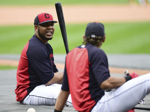 Cleveland Indians' Edwin Encarnacion, left, talks with Erik Gonzalez during a team workout, Tuesday, Oct. 10, 2017, in Cleveland. The Indians will play the New York Yankees Wednesday in Game 5 of the ALDS. (AP Photo/David Dermer)