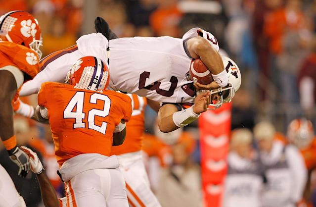 CHARLOTTE, NC - DECEMBER 03: Logan Thomas #3 of the Virginia Tech Hokies tries to jump over the line during the ACC Championship game against the Clemson Tigers at Bank of America Stadium on December 3, 2011 in Charlotte, North Carolina. (Photo by Mike Ehrmann/Getty Images)